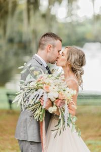 newlyweds kissing while working with Charleston wedding planners
